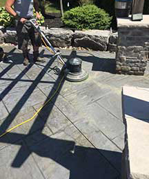 Using a scrubbing machine to speed decorative concrete sealer